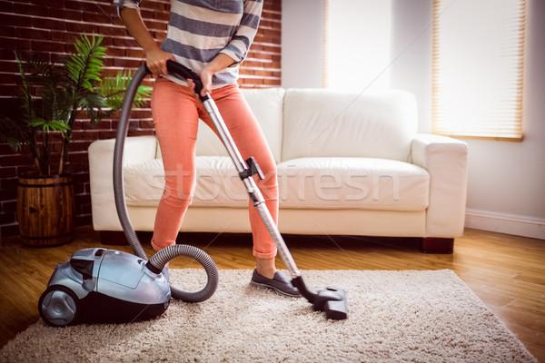 Woman hoovering the rug Stock photo © wavebreak_media