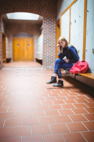 Worried student sitting with hand on head Stock photo © wavebreak_media