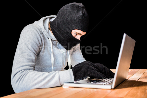 Fókuszált tolvaj gépel laptop fekete férfi Stock fotó © wavebreak_media