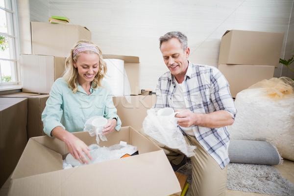 Smiling couple packing mug in a box Stock photo © wavebreak_media
