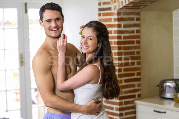Young couple feeding fruits to each other Stock photo © wavebreak_media
