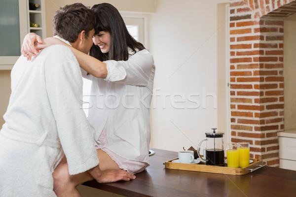 Fiatal pér átkarol egyéb romantikus konyha ház Stock fotó © wavebreak_media