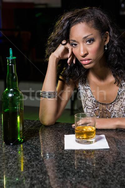 Deprimido mulher uísque bar contrariar beber Foto stock © wavebreak_media