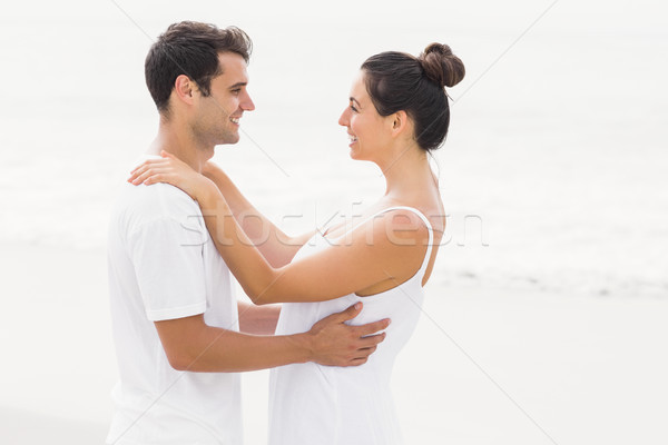Happy couple embracing each other on the beach Stock photo © wavebreak_media