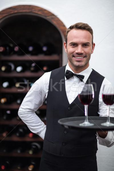 Waiter with tray of red wine Stock photo © wavebreak_media