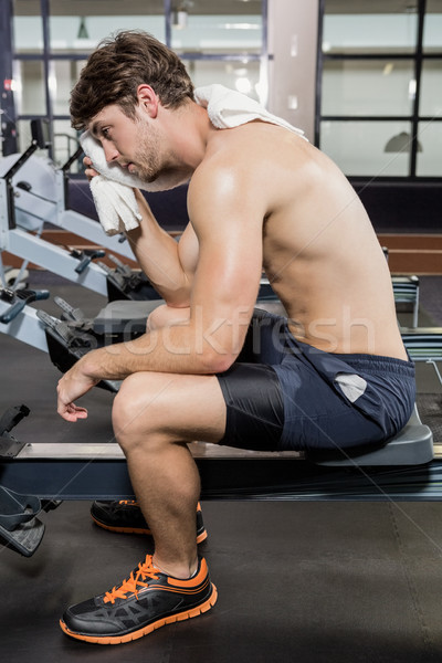 Tired man wiping his face after workout Stock photo © wavebreak_media