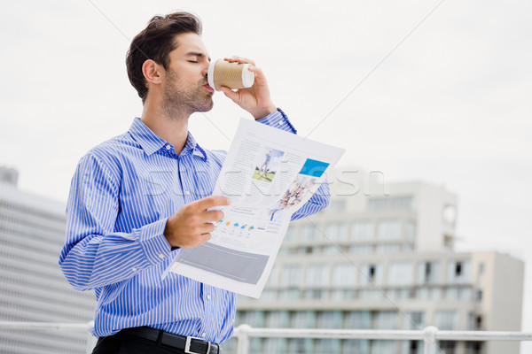 Stock photo: Businessman reading a newspaper