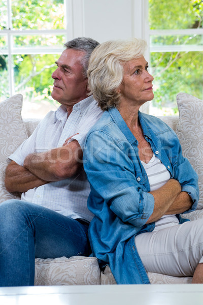 Annoyed senior couple sitting back to back on sofa Stock photo © wavebreak_media