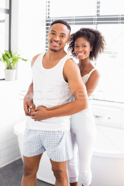 Stock photo: Young couple embracing each other in bathroom