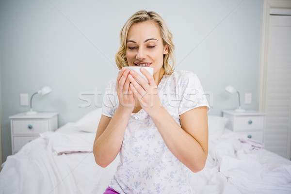 Woman having coffee in bed Stock photo © wavebreak_media