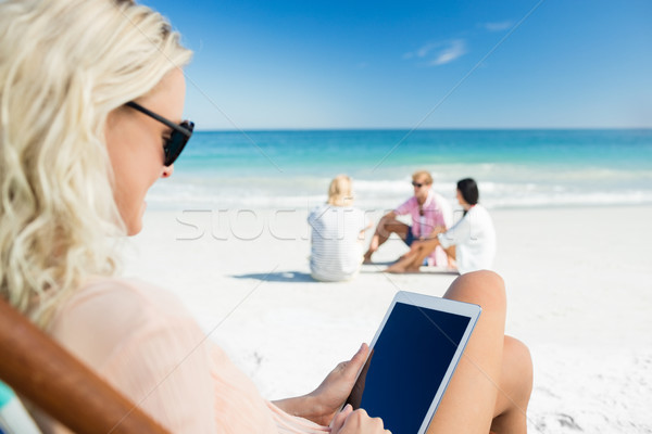 Young woman using digital tablet Stock photo © wavebreak_media