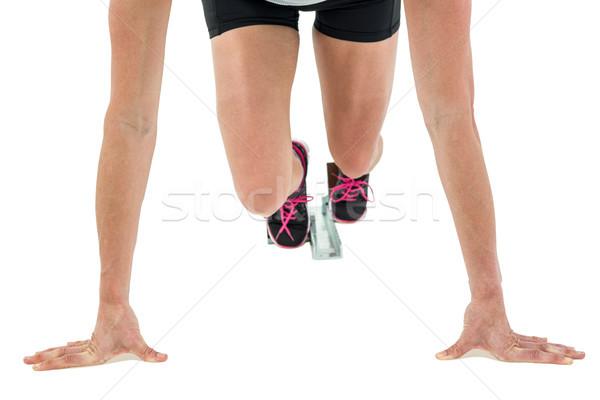 Vrouwelijke atleet positie klaar lopen witte Stockfoto © wavebreak_media