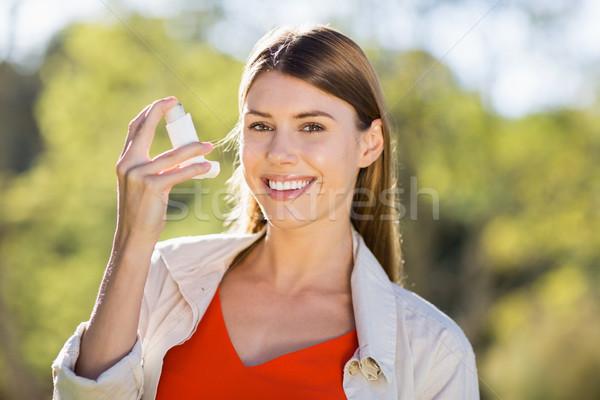 Portrait of beautiful woman using asthma inhaler Stock photo © wavebreak_media
