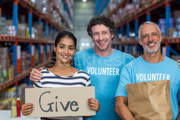 Portret szczęśliwy wolontariusz stwarzające twarz Zdjęcia stock © wavebreak_media