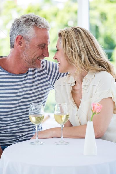 Romantic smiling mature couple with white wine Stock photo © wavebreak_media