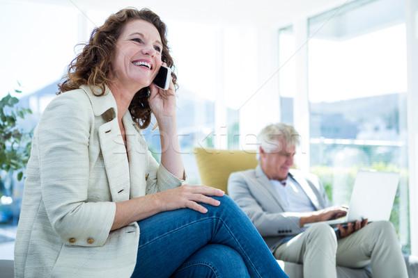 улыбающаяся женщина человека говорить мобильного телефона улыбаясь Сток-фото © wavebreak_media