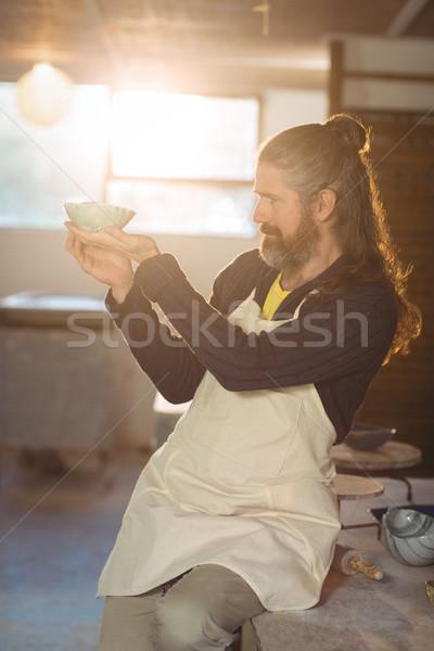 Male potter checking bowl Stock photo © wavebreak_media