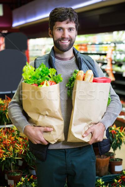 肖像 笑みを浮かべて 男 食料品 袋 ストックフォト © wavebreak_media