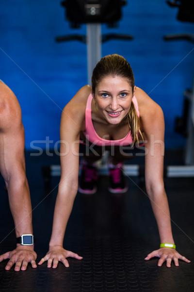 Young female athlete doing push-ups Stock photo © wavebreak_media