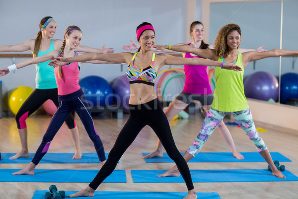 Group of women performing stretching exercise Stock photo © wavebreak_media