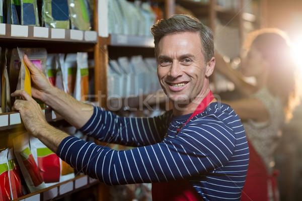 Portrait of male staff arranging grocery items on shelf Stock photo © wavebreak_media