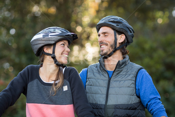 Biker couple smiling and looking at each other Stock photo © wavebreak_media