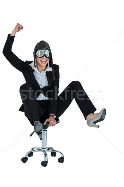 Businesswoman wearing aviator glasses sitting on office chair Stock photo © wavebreak_media