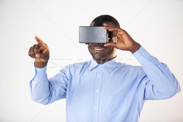 Homem virtual realidade fone branco diversão Foto stock © wavebreak_media