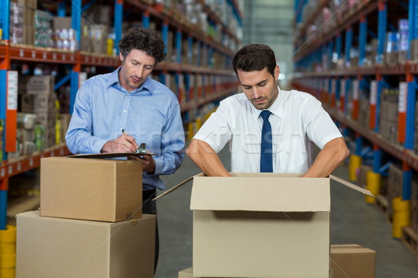 Two warehouse workers checking the boxes  Stock photo © wavebreak_media