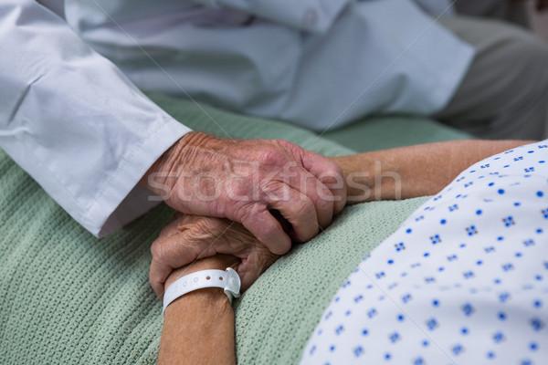 Doctor consoling senior patient in hospital Stock photo © wavebreak_media