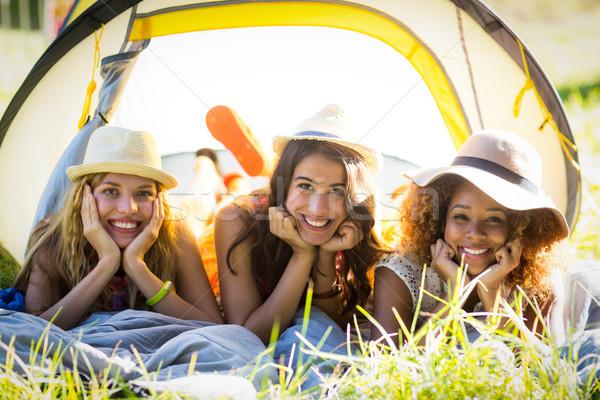 Barátok fű portré táborhely napos idő szeretet Stock fotó © wavebreak_media