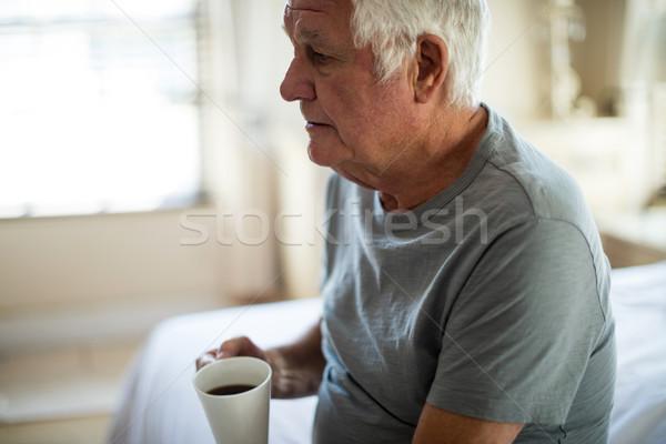 Zamyślony starszy człowiek kubek kawa czarna Zdjęcia stock © wavebreak_media