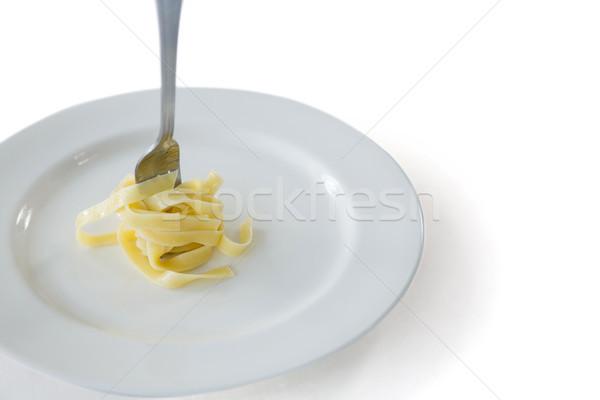 Spagetti tekert felfelé villa tányér fehér Stock fotó © wavebreak_media