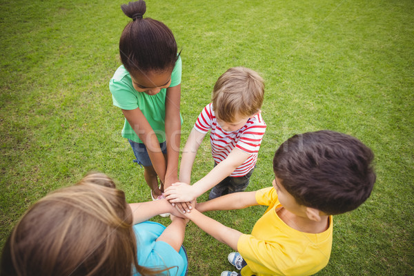 Diverse classmates putting hands together Stock photo © wavebreak_media