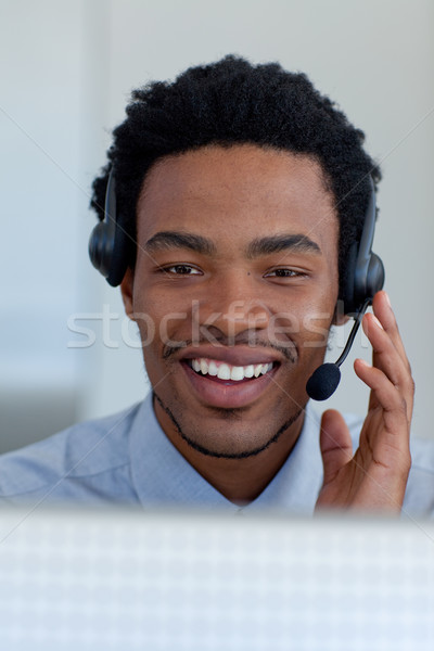 Afro-American young businessman in a call center Stock photo © wavebreak_media