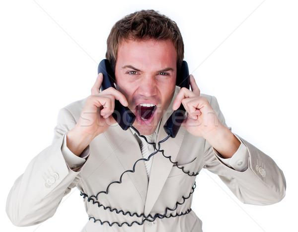 Empresário para cima telefone fios isolado Foto stock © wavebreak_media
