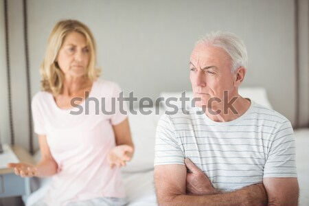 Senior woman sitting on a wheelchair with a neck brace talking with her doctor Stock photo © wavebreak_media