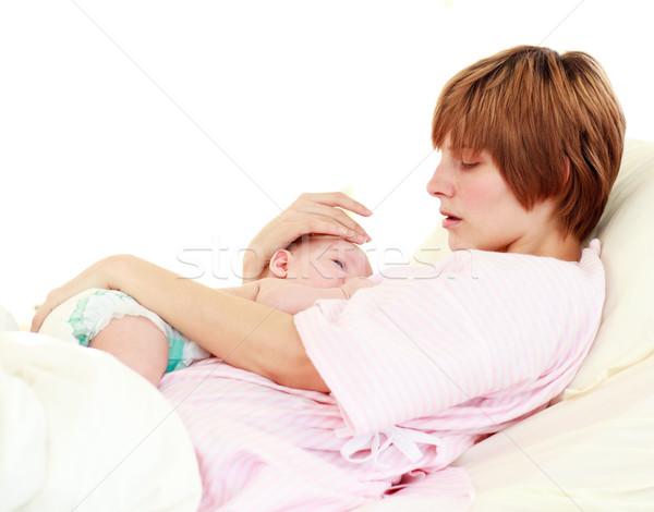 Patient caring for her newborn baby in bed Stock photo © wavebreak_media