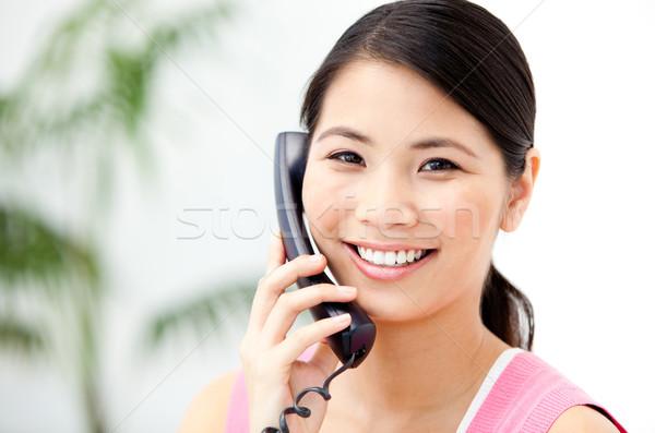 Portret wesoły kobieta interesu mówić telefonu biuro Zdjęcia stock © wavebreak_media