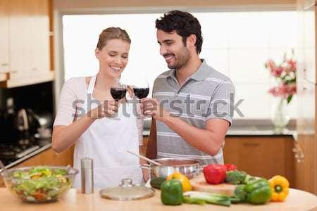 Mulher beijando namorado vinho branco cozinha Foto stock © wavebreak_media