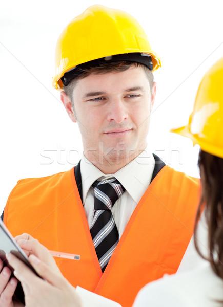 Karizmatikus építész megbeszél kolléga fehér mosoly Stock fotó © wavebreak_media