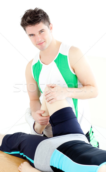 Young male physical therapist checking a woman's knee  Stock photo © wavebreak_media