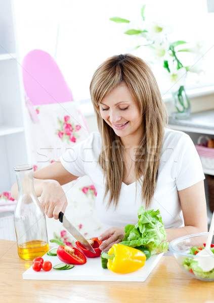 Cheerful woman preparing a healthy meal in the kitchen Stock photo © wavebreak_media