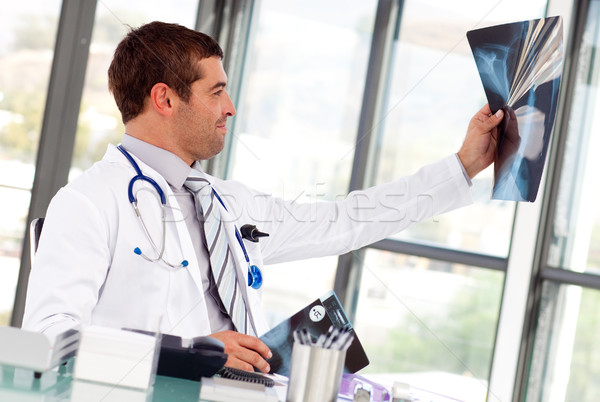 Handsome doctor looking at a x-ray Stock photo © wavebreak_media