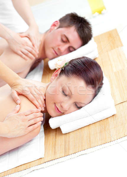 Attractive young couple receiving a back massage in a spa center Stock photo © wavebreak_media