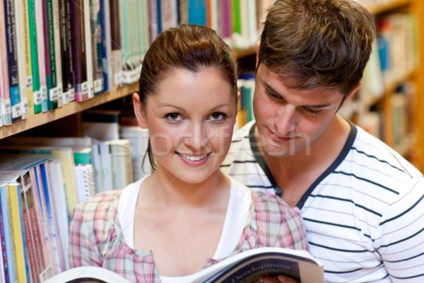 Young caucasian couple reading a book in a bookstore Stock photo © wavebreak_media