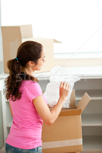 Attractive hispanic woman unpacking a box of glasses in her new house Stock photo © wavebreak_media