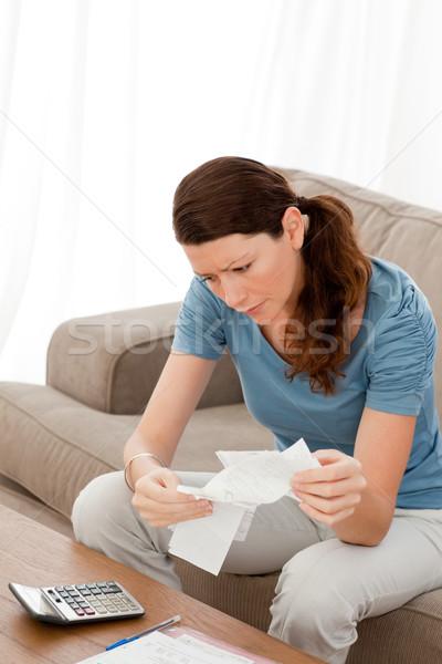 Donna guardando seduta divano Foto d'archivio © wavebreak_media