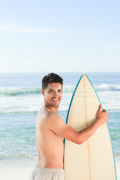 Knappe man surfboard strand hemel water man Stockfoto © wavebreak_media