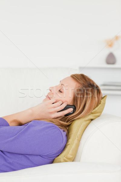 Profil portré derűs nő telefonál kanapé nappali Stock fotó © wavebreak_media